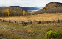 Obvious Connections A split rail fence defines the boundaries of a pasture