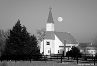 Between Heaven and Earth The December full moon rises above a country church in